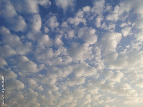 Altostratus, white clouds in the blue sky natural background beautiful nature en Wallpaper Mural