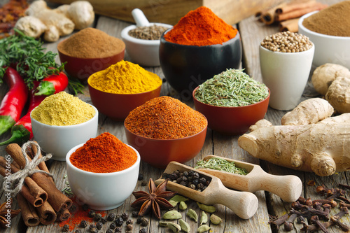 Fototapeta Various aromatic colorful spices and herbs. Ingredients for cooking..Ayurveda treatments. obraz