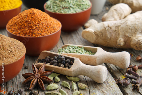 Fototapeta Aromatic spices and herbs. Ingredients for cooking. Ayurveda treatments.. obraz
