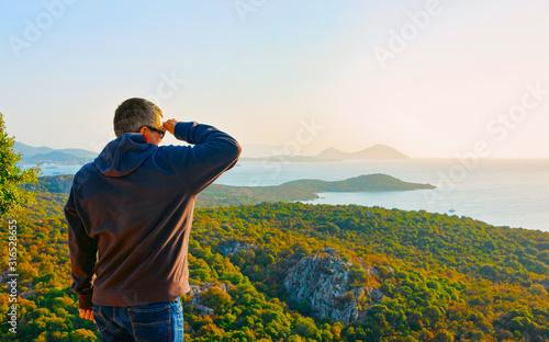 Scenery with man at Porto Rotondo at sunrise or sunset at Mediterranean Sea on Costa Smeralda Canvas Print