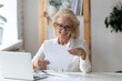 Leinwanddruck Bild - Mature businesswoman holding letter reading paper document feels satisfied