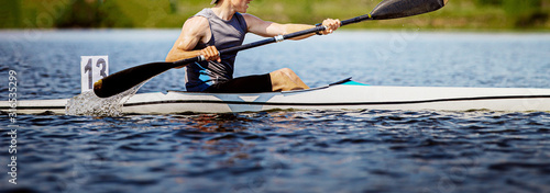 Obraz na plátne close up athlete kayaker rowing kayaking competition race