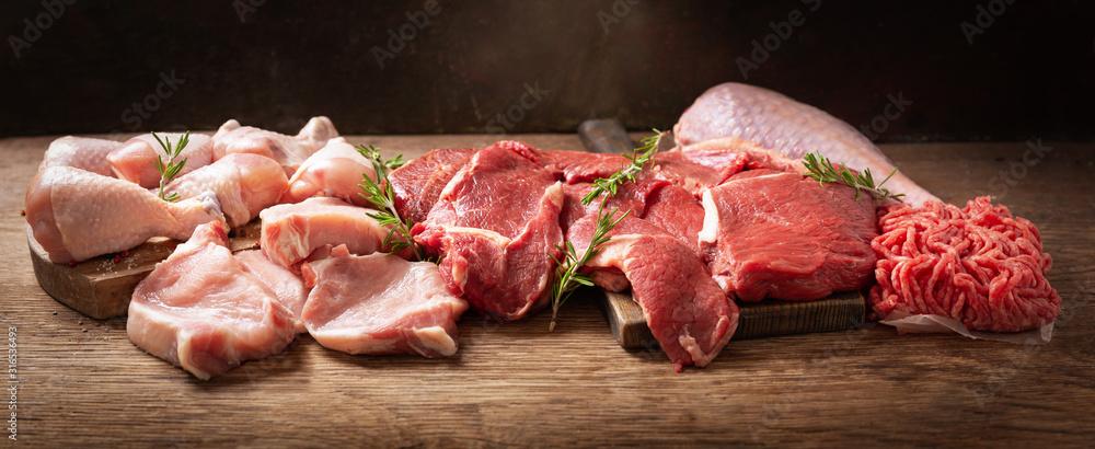 Fototapeta various types of fresh meat: pork, beef, turkey and chicken