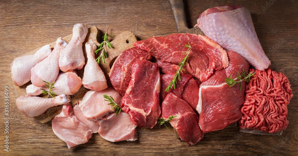 Fototapeta various types of fresh meat: pork, beef, turkey and chicken,  top view