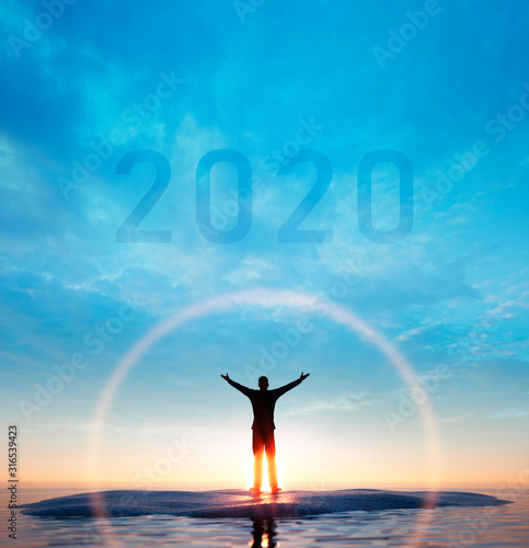 Fototapeta Silhouette of a man and 2020 concept in beautiful sunset sky and sea background - 3D illustration obraz