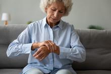 Unhappy Older Woman Massaging ...