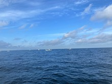 Sea, The Sky And Fishing Boat.