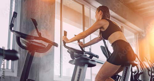 Fitness woman in training showing exercises with exercise-machine in gym, fitness concept, sport concept Fototapet