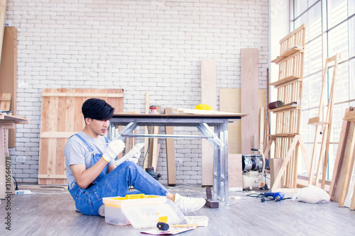 Photo A man is thinking about plan of room renovation