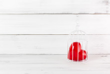 Red Heart Inside Bird Cage On ...