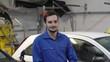 Portrait of apprentice standing in mechanics workshop
