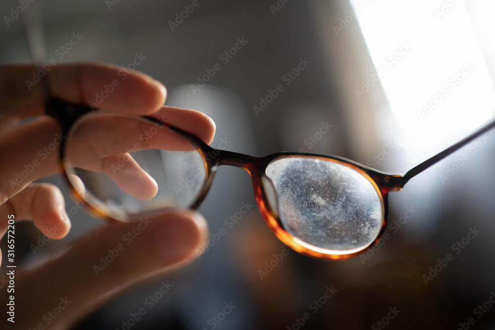 Fototapeta Eyeglasses with dirty marks on lens