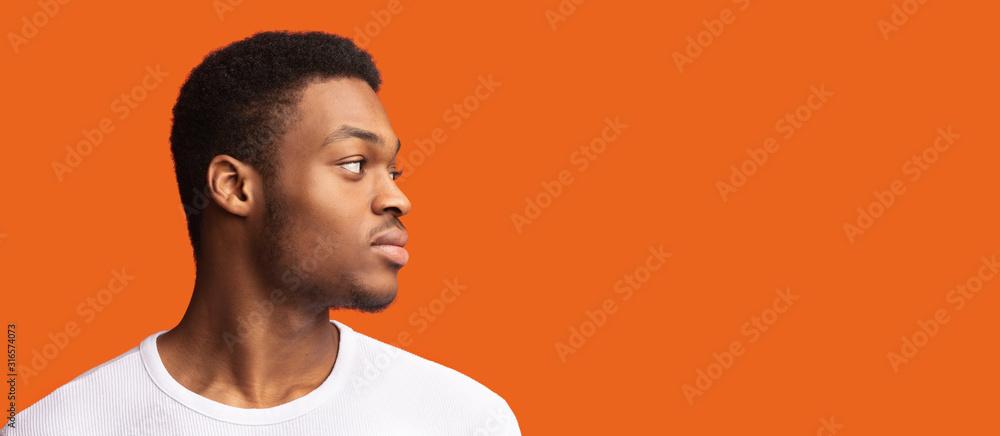 Fototapeta Side portrait of masculine afro guy looking at copyspace