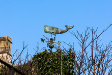 A Weather Vane In The Shape Of A Sperm Whale Above An Ivy Covered Roof In Bradford On Avon
