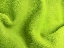 Crumpled Warm Green Polar Fleece Fabric Closeup