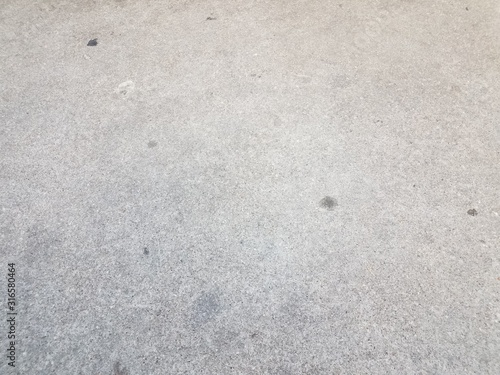 grey asphalt or ground or surface with stains