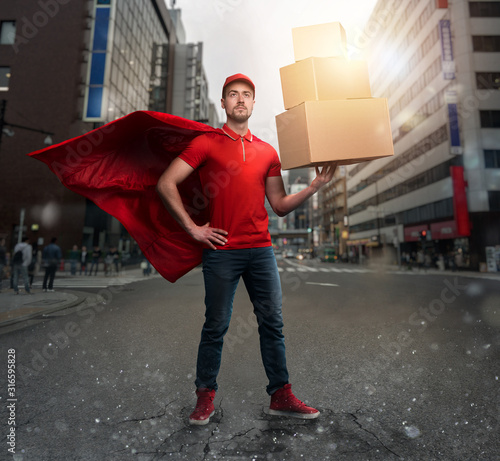 Fotografía Courier acts like a powerful superhero in a city with skyscrapers