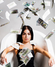 Currency, Women, Winning. Bank Concept. Sexy Female And Dollar Bills. Woman With Lot Of Money. Millionaire Woman Lying In Bedroom. Sexy Woman Lies On Money