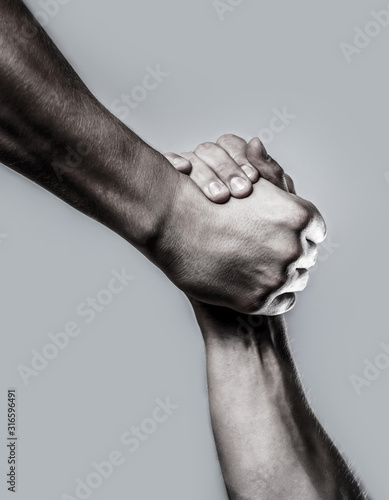 Rescue, helping hand. Two hands, helping hand of a friend. Black and white. Man help hands, guardianship, protection. Handshake, arms. Friendly handshake, friends greeting