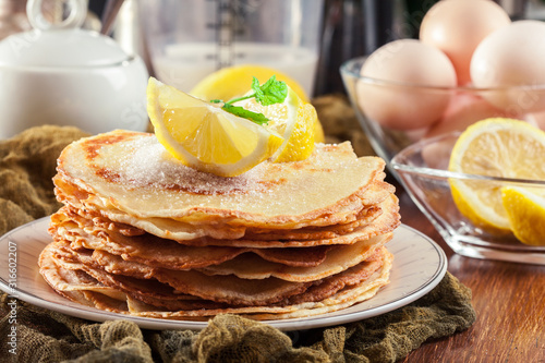 Fototapeta British pancakes with lemon and sugar obraz