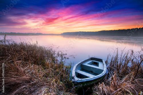 Fototapeta Beautiful sunrise over lake banks obraz