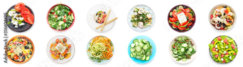Set of different tasty salads on white background Fototapete