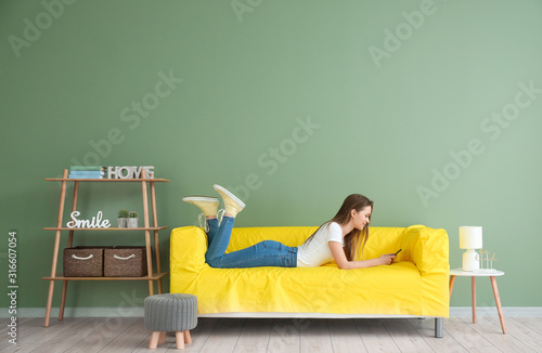 Young woman in room with operating air conditioner Canvas Print