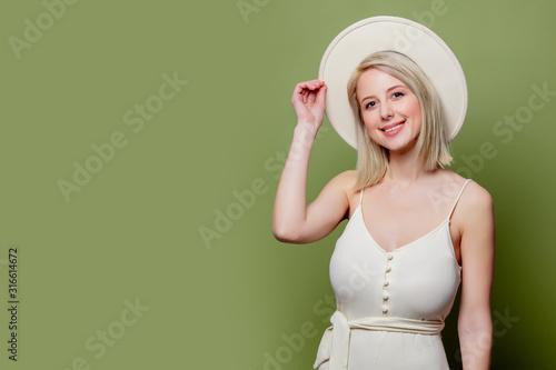 Beautiful blonde girl in white hat and dress Slika na platnu