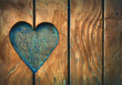 canvas print picture - One heart shape carved in vintage wood close up