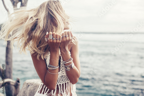 Cuadros en Lienzo Boho model wearing crochet top and silver jewelry on the beach