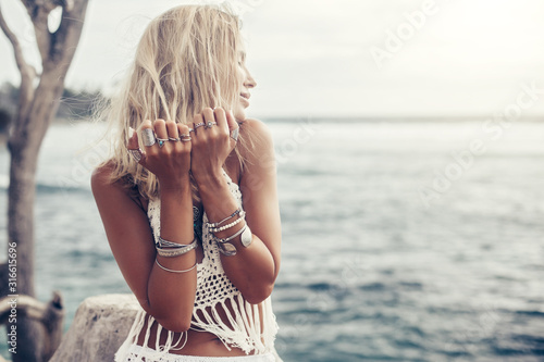 Boho model wearing crochet top and silver jewelry on the beach Canvas Print