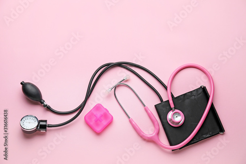Composition with sphygmomanometer on color background Wallpaper Mural