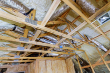 Installing Attic Insulation Material Is Sprayed With Liquid Foam Of Heating System On The Roof