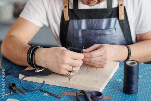 Cuadros en Lienzo  Craftsman working on handmade leather product