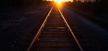 These Are Railroad Tracks That Go Off Into Infinity At Sunrise. The Sun Is At The End Of The Tracks At The Horizon.