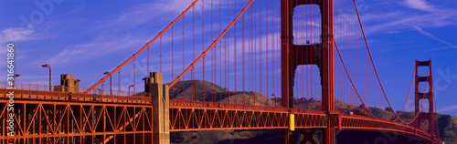 фотография This is a close up view of the Golden Gate Bridge with a view of Marin County in the background