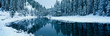Leinwanddruck Bild - This is the Lake Tahoe area after a winter snow storm. There is snow covering the trees surrounding a stream. The winter trees are reflected in the stream.