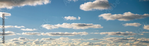 This is a blue sky and clouds in summer. Canvas-taulu