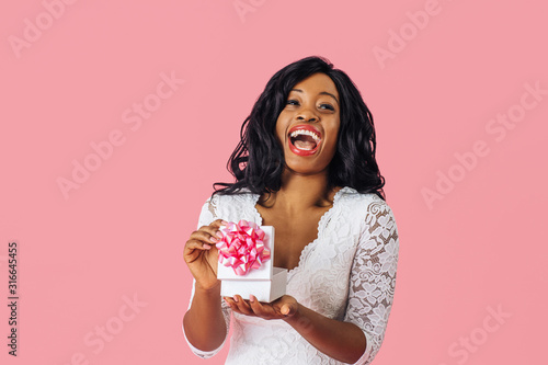 Portrait of  young happy woman having a great reaction while opening a birthday, Canvas Print