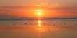 canvas print picture - Sonnenuntergang am Meer in Indonesien