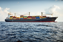 Large Cargo Container Ship With Cranes In The Baltic Sea On A Clear Sunny Day. Latvia