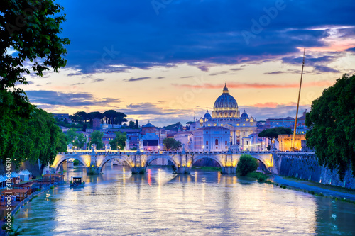 Obraz A view along the Tiber River towards St. Peter's Basilica and the Vatican in Rome, Italy. - fototapety do salonu