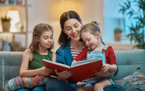 Fotografie, Obraz mother reading a book to daughters