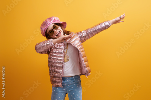 Kid on bright color background. - 316650863