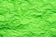 Leinwandbild Motiv Green crumpled paper background or texture in detail
