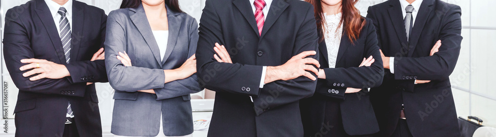 Fototapeta Successful professional group of business people man and woman team standing folded hand at office