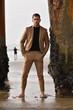Sexy stylish man on the beach