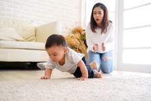 Serious Asian Little Boy Crawl...