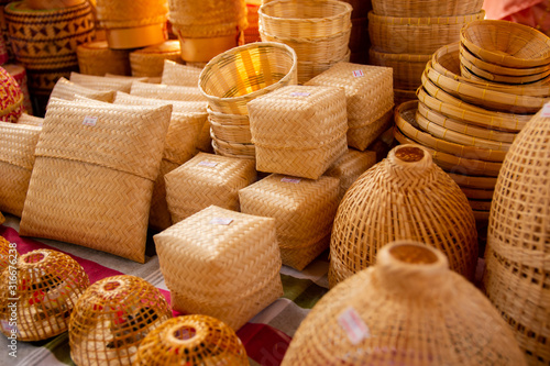 Photo Bamboo wickerware in various shape, put on the table for sale in the market