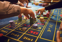 Roulette Table Chips In A Casino. Gamblers Make Bets In A Casino.